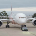 Tesla Model X towing Boeing 787-9 Dreamliner (2018, Qantas) photos