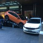 Valet parks Porsche 911 convertible under Subaru in Sydney, is cut out