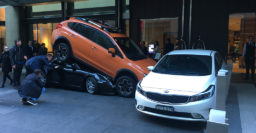 Valet parks Porsche 911 convertible under Subaru in Sydney, is cut out