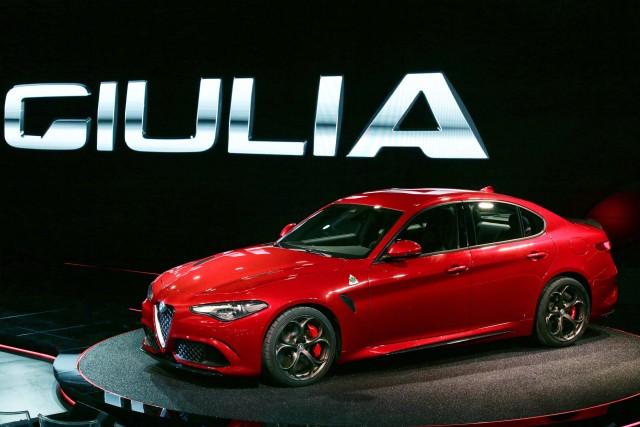 Type 952 Alfa Romeo Giulia Quadrifoglio Verde - front, profile, red, at launch event