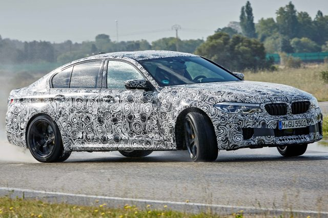 F90 BMW M5 sedan development vehicle - front, sideways, sliding