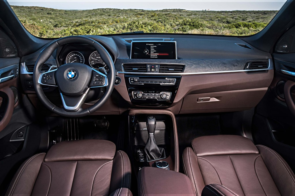 F48 BMW X1 xDrive20d - interior, dark red and black