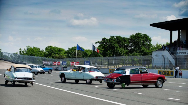 Citroen DS 60th anniversary meeting - selection of cars driving without on rear wheel