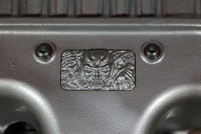 Custom Demon diecast emblem located on the cover of the 6.2-lite