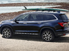 2019 Honda Pilot facelift - rear, blue, surfboard on roof