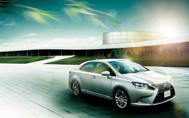 2015 ANF10 Lexus HS250h - front, driving, silver