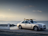 2018 Rolls-Royce Ghost with roof rack and surfboard