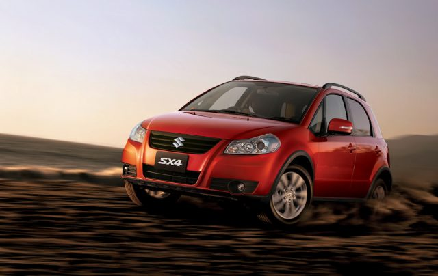 2012 Suzuki SX4 facelift - front, orange