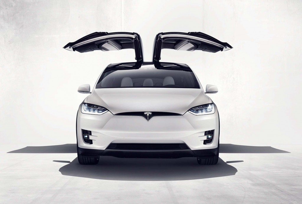 Tesla Model X - falcon wing doors open, front