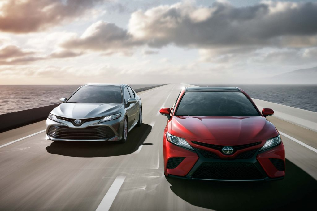 2018 Toyota Camry Hybrid - red and silver, bridge, driving
