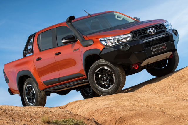 Toyota HiLux Rugged X - front, orange