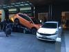 Porsche Boxster parked under Subaru XV Crosstrek